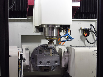 Simultaneous five-axis control processing machine